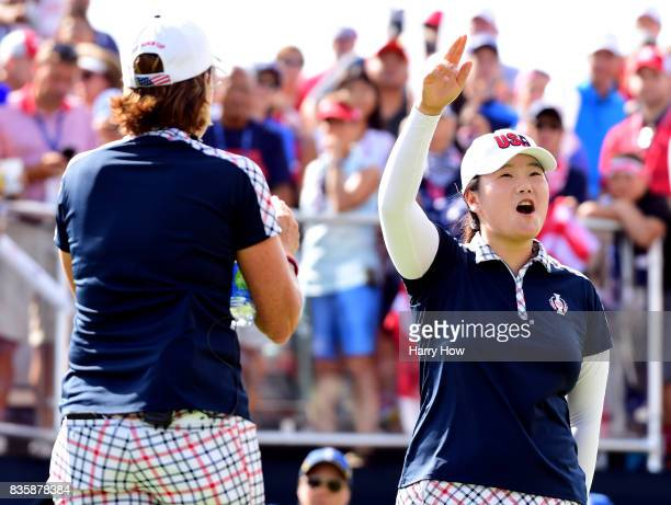 Angel Yin and Juli Inkster of the United States play with the crowd on the first tee before her match against Karine Icher of Team Europe during the...