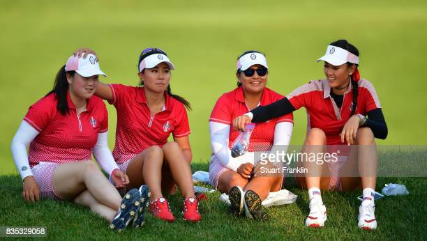 Angel Yin Danielle Kang Lizette Salas and Michelle Wie look on during the afternoon fourball matches of The Solheim Cup at Des Moines Golf and...