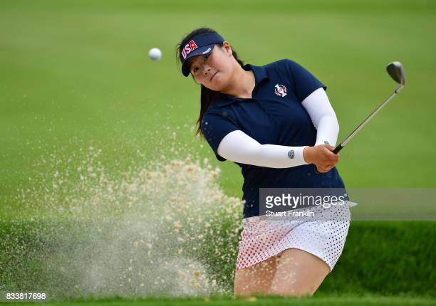 Angel Yin of Team USA plays a bunker shot during practice prior to The Solheim Cup at Des Moines Golf and Country Club on August 17 2017 in West Des...