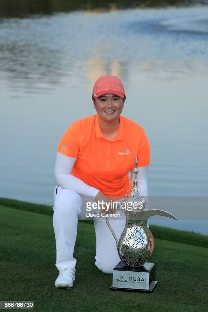 Angel Yin of the United States holds the trophy after her playoff victory during the final round of the 2017 Dubai Ladies Classic on the Majlis...