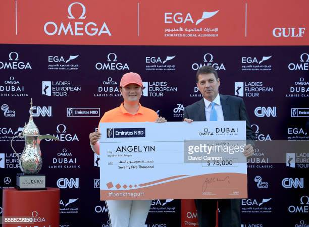 Angel Yin of the United States is presented with the champions cheque by Jonathan Morris the Executive Vice President and Group Head of Wholesale...