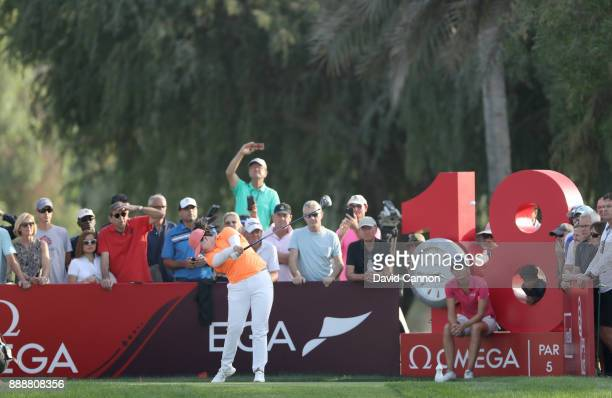 Angel Yin of the United States plays her tee shot on the par 5 18th hole as Anne Van Dam sits and watches during the final round of the 2017 Dubai...