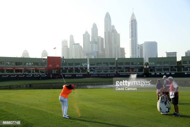 Angel Yin of the United States plays her third shot on the 18th hole the first playoff hole during the final day of the 2017 Dubai Ladies Classic on...