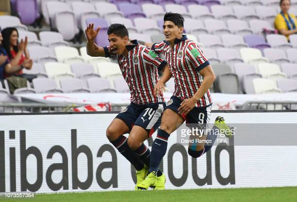 Angel Zaldivar of CD Guadalajara celebrates with teammate Alan Pulido after scoring his team's first goal during the FIFA Club World Cup UAE 2018...