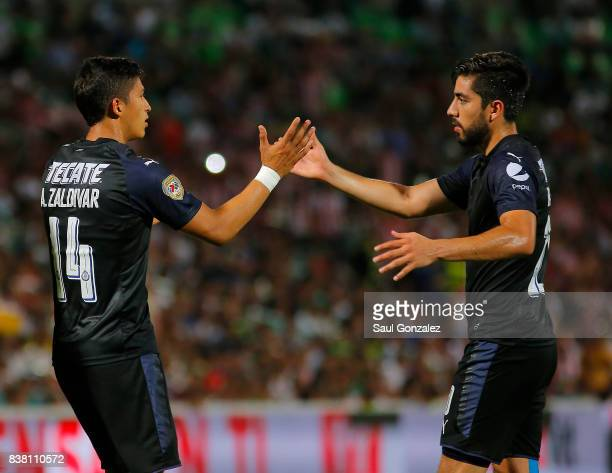 Angel Zaldivar of Chivas celebrates with teammate Rodolfo Pizarro after scoring the first goal of his team during the sixth round match between...