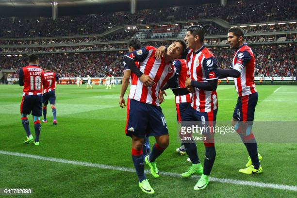 Angel Zaldivar of Chivas celebrates with teammates after scoring his team's first goal during the 7th round match between Chivas and America as part...