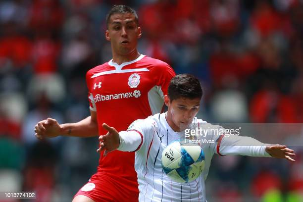 Angel Zaldivar of Chivas struggles for the ball with Omar Tobio of Toluca during the third round match between Toluca and Chivas as part of the...