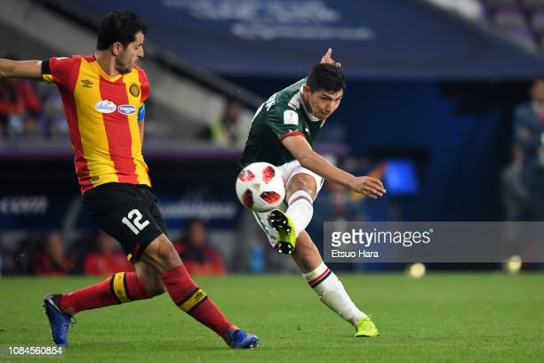Angel Zaldivar of Guadalajara and Khelil Chamman of Tunis compete for the ball during the match between ES Tunis and CD Guadalajara on December 18,...
