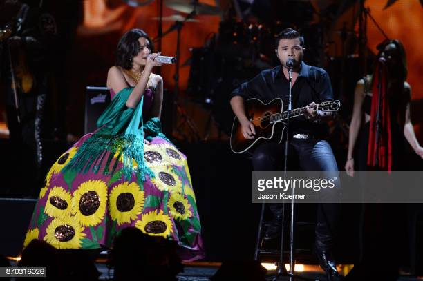 Angela Aguilar and Leonardo Antonio Alguilar perform onstage during the iHeartRadio Fiesta Latina Celebrating Our Heroes at American Airlines Arena...