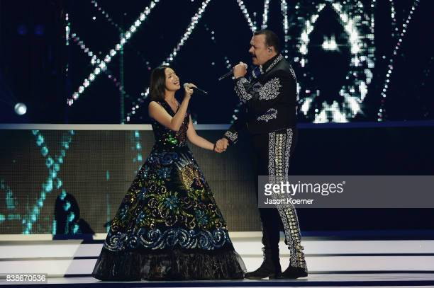Angela Aguilar and Pepe Aguilar perform on stage at Telemundo's 2017 'Premios Tu Mundo' at American Airlines Arena on August 24 2017 in Miami Florida