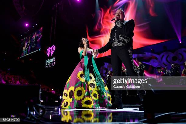 Angela Aguilar and Pepe Aguilar perform onstage during the iHeartRadio Fiesta Latina Celebrating Our Heroes at American Airlines Arena on November 4...
