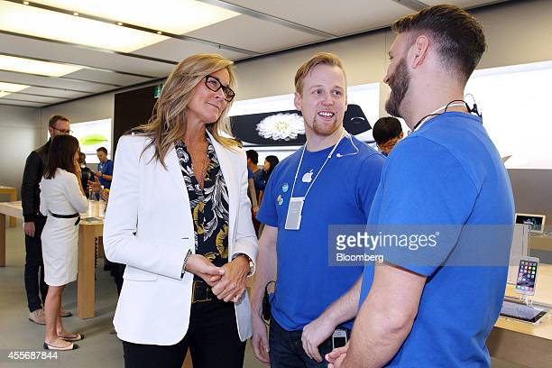 Angela Ahrendts, senior vice president of retail and online stores at Apple Inc., left, chats with employees at the company's George Street store...