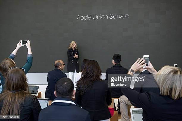Angela Ahrendts senior vice president of retail at Apple Inc speaks during an event inside the company's new flagship store at Union Square in San...