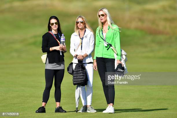Angela Akins Gala Ortin and Sofia Lundstedt watch the action during a practice round prior to the 146th Open Championship at Royal Birkdale on July...