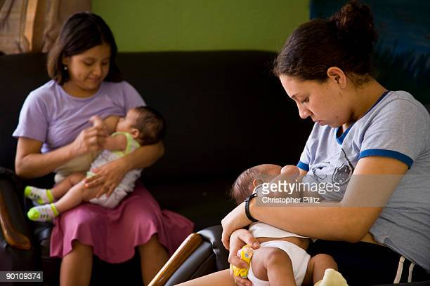 Angela and Elena breast feed their recently born babies in a 'Casa Alianza' refuge for 'ninas madres' child mothers as they are known Angela is from...