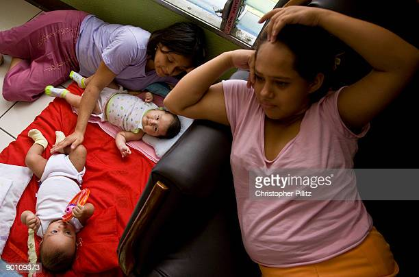 Angela and Maria also 12 attend to their recently born babies in a Casa Alianza refuge for ninas madres child mothers as they are known Angela is...