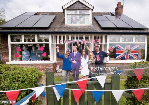 Angela and Richard Rooke and their daughter Jessica with their house near Tadcaster in Yorkshire that they have decorated ahead of the royal wedding...