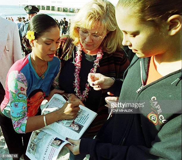 Angela Baraquio Miss America 2001 signs her autograph after taking the traditional dip into the Atlantic Ocean on the first morning of her reign 15...