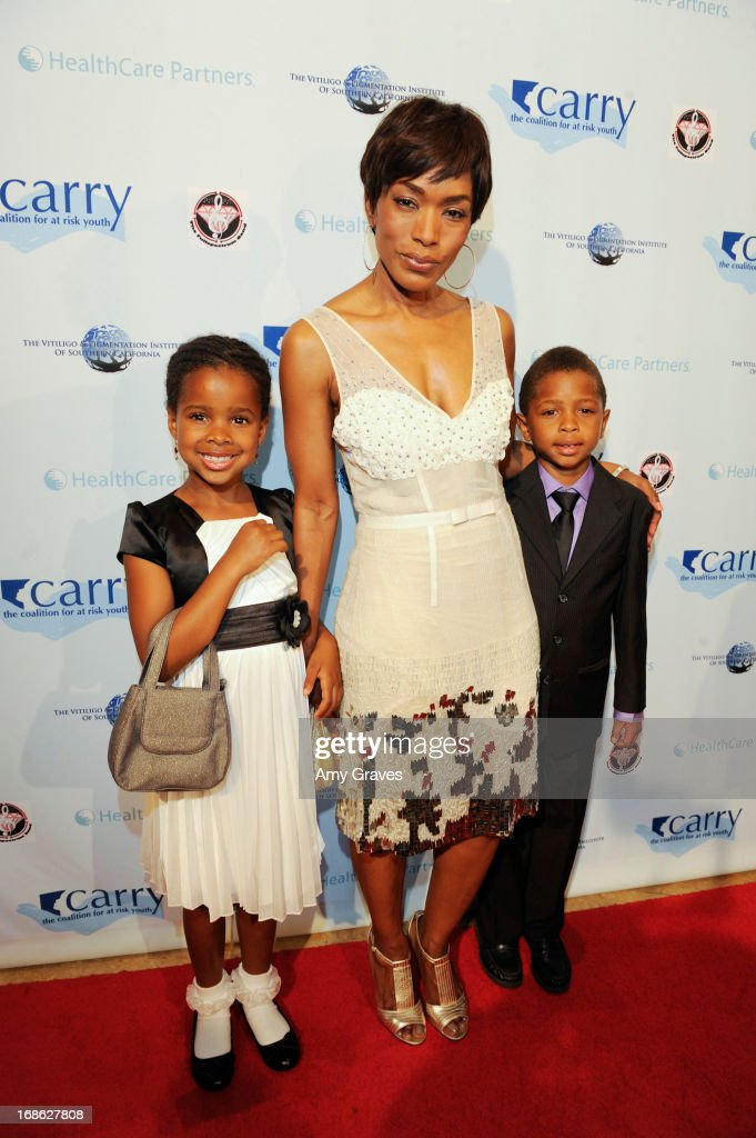 Angela Bassett and children attend the CARRY Foundation's 7th Annual 'Shall We Dance' Gala at The Beverly Hilton Hotel on May 11, 2013 in Beverly Hills, California.