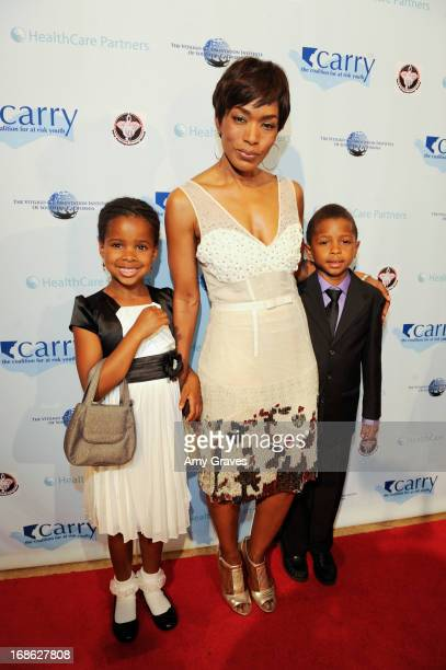 Angela Bassett and children attend the CARRY Foundation's 7th Annual 'Shall We Dance' Gala at The Beverly Hilton Hotel on May 11 2013 in Beverly...