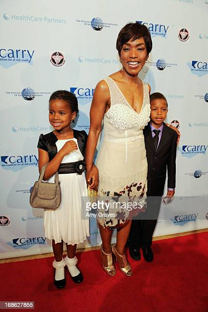 Angela Bassett and children attend the CARRY Foundation's 7th Annual Shall We Dance Gala at The Beverly Hilton Hotel on May 11 2013 in Beverly Hills...