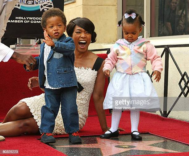 Angela Bassett and her children attend the ceremony honoring her with a star on the Hollywood Walk of Fame on March 20 2008 in Hollywood California
