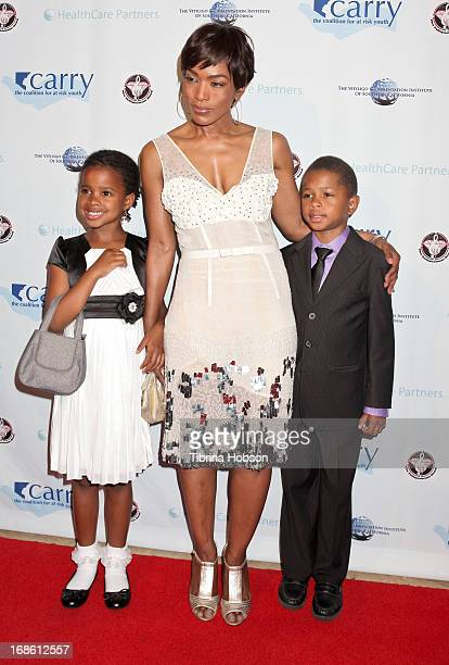 Angela Bassett and her children Bronwyn Vance and Slater Vance attend the 'Shall We Dance' annual gala for the coalition for atrisk youth at The...