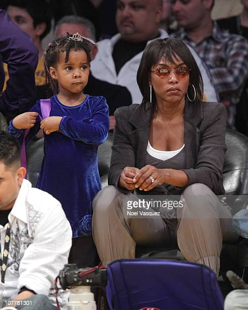 Angela Bassett and her daughter Bronwyn Golden Vance attend a game between the Miami Heat and the Los Angeles Lakers at Staples Center on December 25...