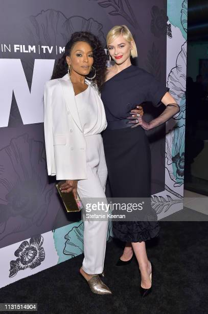 Angela Bassett and Jaime King, both wearing Max Mara attend the 12th Annual Women in Film Oscar Nominees Party Presented by Max Mara with additional...