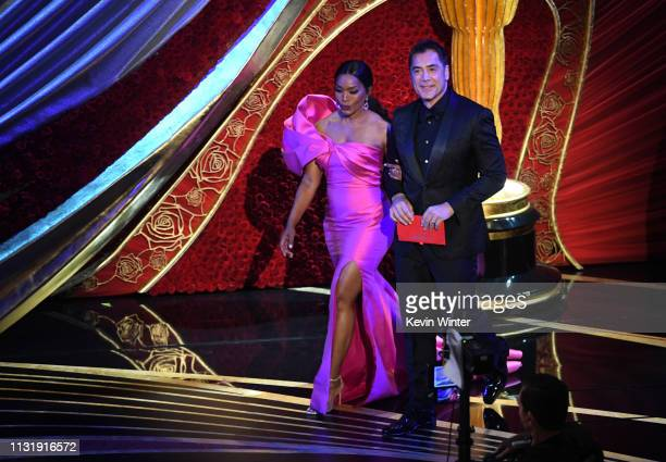 Angela Bassett and Javier Bardem walk onstage during the 91st Annual Academy Awards at Dolby Theatre on February 24 2019 in Hollywood California