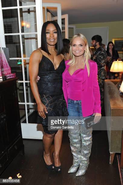 Angela Bassett and Kristin Chenoweth attend Christian Siriano's celebration of the launch of his new book 'Dresses To Dream About' in Los Angeles at...