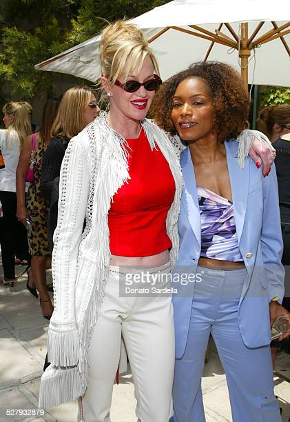 Angela Bassett and Melanie Griffith during Versace Luncheon to Benefit Children's Action NetworkWestside Children's Center Sponsored By InStyle...