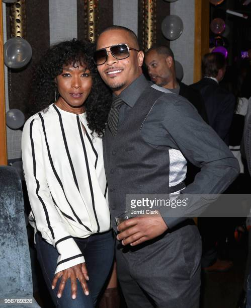 Angela Bassett and TI attend The Stevie Wonder Song Party at The Peppermint Club on May 9 2018 in Los Angeles California