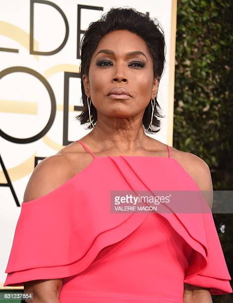 Angela Bassett arrives at the 74th annual Golden Globe Awards January 8 at the Beverly Hilton Hotel in Beverly Hills California / AFP / VALERIE MACON