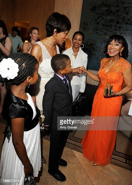 Angela Bassett Dr Pearl Grimes and children attend the CARRY Foundation's 7th Annual Shall We Dance Gala at The Beverly Hilton Hotel on May 11 2013...