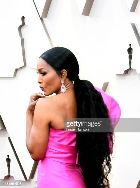 Angela Bassett hair earring and fashion details attends the 91st Annual Academy Awards at Hollywood and Highland on February 24 2019 in Hollywood...