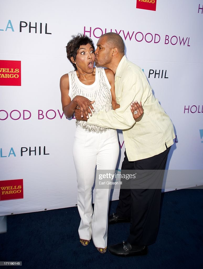 Angela Bassett is stunned by fellow actor Eriq La Salle at the Hollywood Bowl Hall Of Fame Opening Night at The Hollywood Bowl on June 22, 2013 in Los Angeles, California.