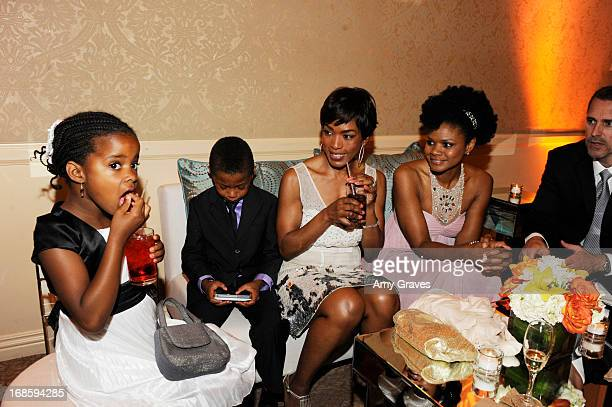 Angela Bassett Kimberly Elise and children attend the CARRY Foundation's 7th Annual 'Shall We Dance' Gala at The Beverly Hilton Hotel on May 11 2013...