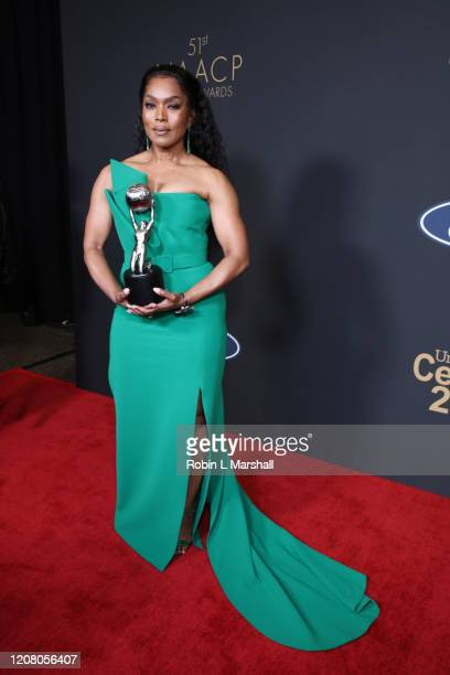 """Angela Bassett poses with the Outstanding Actress in a Drama Series award for """"9-1-1"""" at the 51st NAACP Image Awards, Presented by BET, at Pasadena..."""