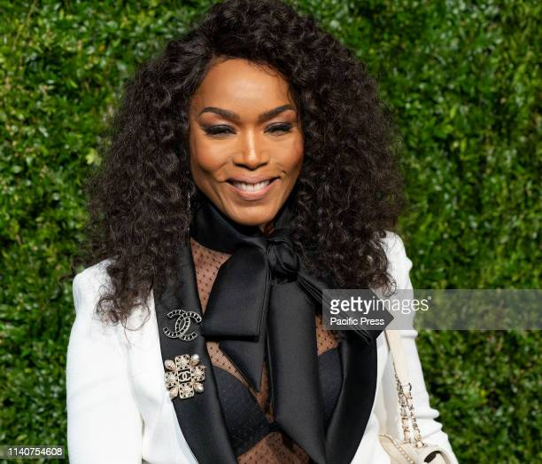 Angela Bassett wearing Chanel attends the Chanel 14th Annual Tribeca Film Festival Artists Dinner at Balthazar