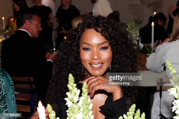 Angela Bassett, wearing Max Mara, with table setting by Meissen porcelain during the Max Mara Resort 2020 Fashion Show at Neues Museum on June 3,...