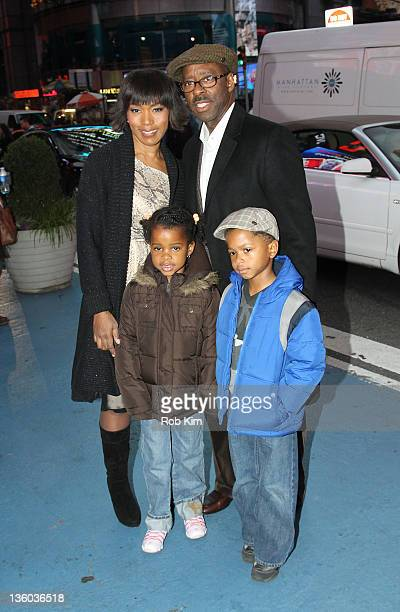 Angela Bassett with husband Courtney B Vance and children at the NASDAQ stock market closing bell on December 20 2011 in New York City