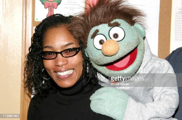 Angela Bassett with Nicky during Angela Bassett and Cast Members of Queer as Folk and Queer Eye for the Straight Visit Backstage at Avenue Q at...