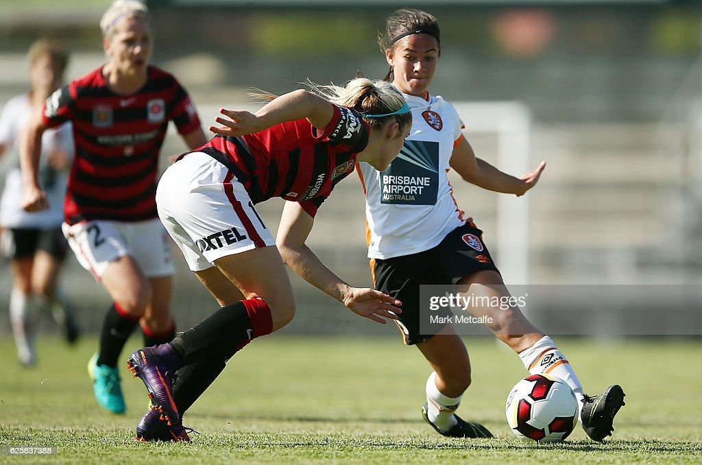 Angela Beard of the Roar takes on Caitlin Cooper of the Wanderers during the round four W-League match between the Western Sydney Wanderers and the Brisbane Roar at Marconi Stadium on November 26, 2016 in Sydney, Australia.