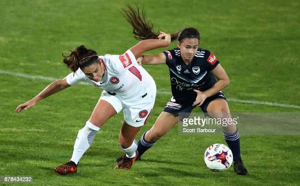 Angela Beard of the Victory and Lee Falkon of the Wanderers compete for the ball during the round eight WLeague match between the Melbourne Victory...