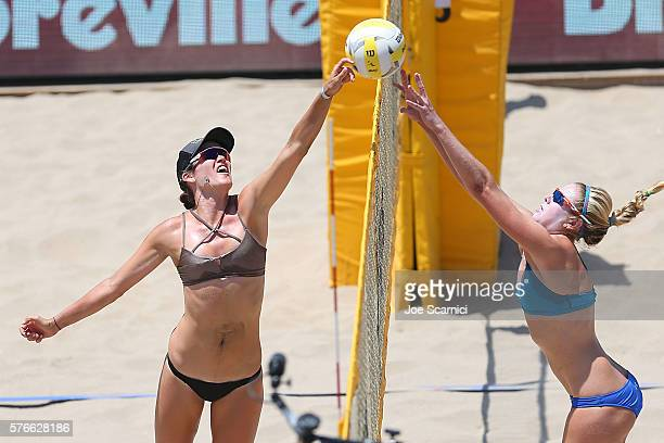Angela Bensend and Summer Ross jump up at the net during their quarter final match at AVP Beach Volleyball Manhattan Beach on July 16 2016 in...