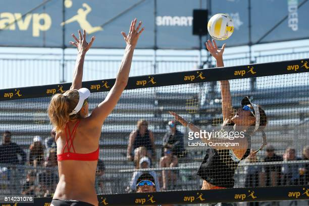 Angela Bensend hits the ball past Alix Klineman in their semifinal match during day 4 of the AVP San Francisco Open at Pier 3032 on July 9 2017 in...