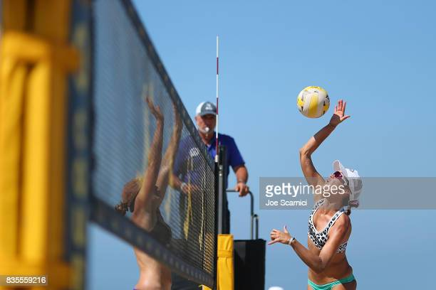 Angela Bensend jumps at the net during her round 4 match at the AVP Manhattan Beach Open Day 3 on August 19 2017 in Manhattan Beach California