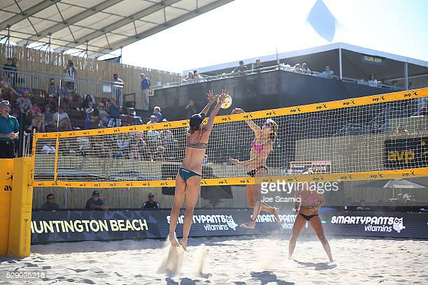 Angela Bensend jumps to block a spike by Sheila Shaw in their quarterfinal match at the AVP Huntington Beach Open on May 07 2016 in Huntington Beach...