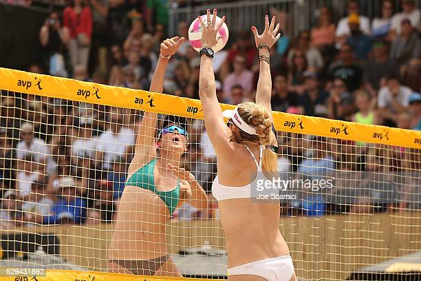 Angela Bensend jumps to spike the ball past a blocking Kerri Walsh Jennings at AVP Huntington Beach Open on May 08 2016 in Huntington Beach California